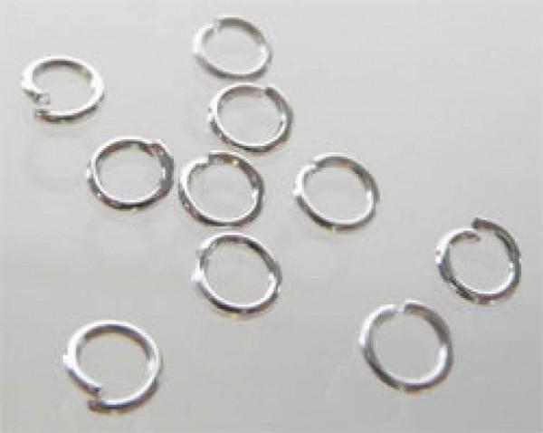 100 Zwischenringe 4mm silber 07777